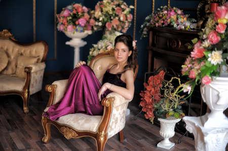 Beautiful girl in a purple dress. Black, caucasian.
