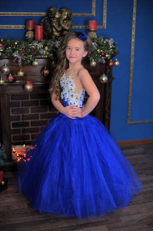 young princess in blue elegant christmas dress