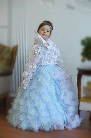 little cute girl young princess in chic white with blue dress, victorian vintage style 免版税图像