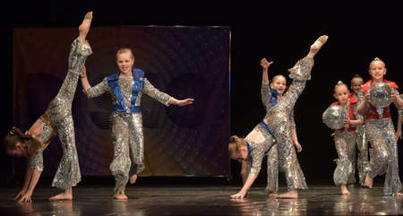 Russia, St. Petersburg 16.06.2019 Performance of a children's dance group in shiny costumes, in the style of disco at the open festival of creativity