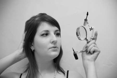 funny photo of a brunette woman doing make-up at home