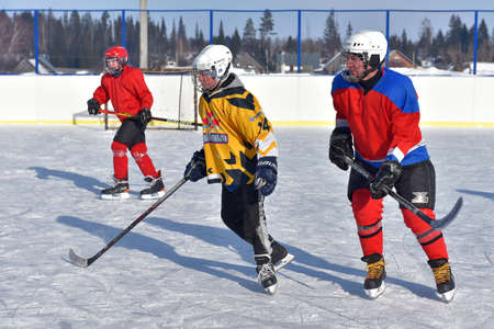 Russia, Kechevo, 12,02,2021 Playing ice hockey on an outdoor ice rink Editorial