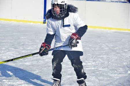 Russia, Kechevo, 12,02,2021 Playing ice hockey on an outdoor ice rink
