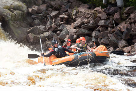 KARELIA REGION, RUSSIA - 18-07-2016: tourist rafting on an inflatable raft on the river from the rapids in Karelia Editorial