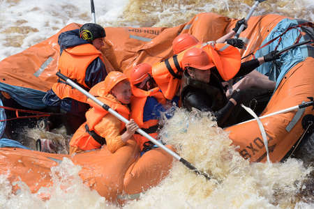 KARELIA REGION, RUSSIA - 18-07-2016: tourist rafting on an inflatable raft on the river from the rapids in Karelia
