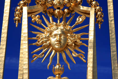 louis: Detail of the golden gate at Versailles palace, France