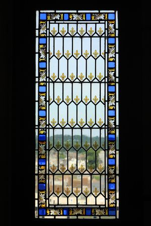 castle interior: Window in medieval church in France, made of stained glass