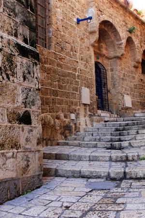 Narrow street in the ancient part of Jaffa, Israel Stock Photo