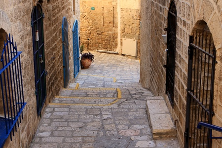 Narrow street in the ancient part of Jaffa, Israel photo