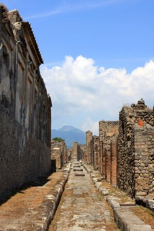Road in Pompeii, buried Roman city near Naples, Italy Stock Photo