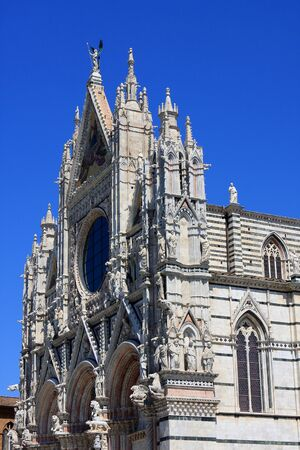 Facade of the Cathedral of Siena, a medieval church in Siena, Italy