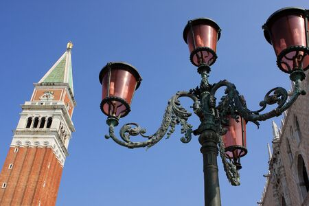 saint mark's:   Lantern and St. Marks Campanile at San Marco Square, Venice, Italy Stock Photo