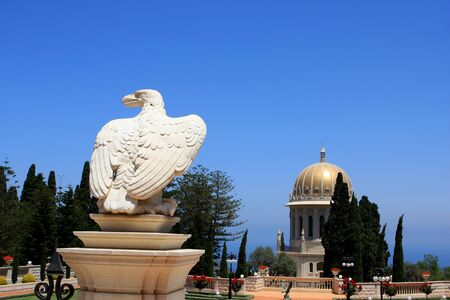 Sculpture in Bahai gardens and view of Shrine of The Bab on mount Carmel, Haifa, Israel
