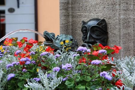 fountain with flowers at the street of Lucerne, Switzerland photo