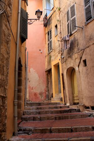 Narrow street in the old city of Grasse, France