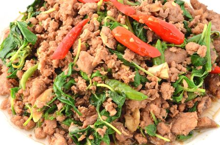 Thai food, Pork,with chili pepper and sweet basil. Stock Photo - 17945183