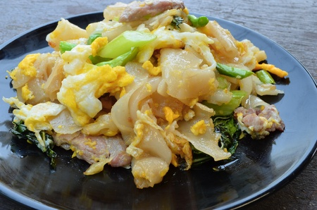 Stir fried noodles with egg, pork, green vetgetables, and sweet Stock Photo - 18047196