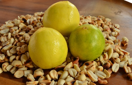 Lemon peanuts background on a wooden table. photo