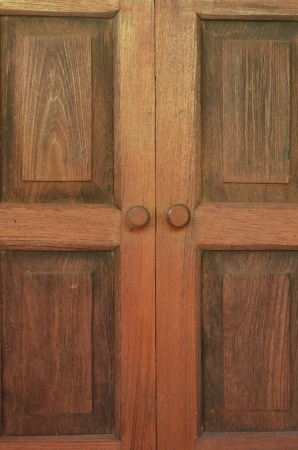 Vintage brown wooden door close-up photo