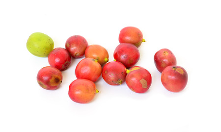 red ripe coffee beans isolated on white background. photo