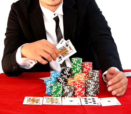 Young handsome man playing texas holdem