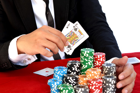 Young handsome man playing texas holdem photo