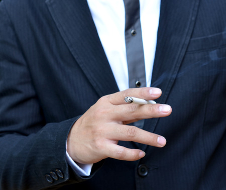 Young man smoking a cigarette photo
