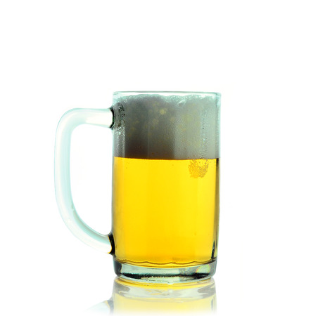 Mug fresh beer with cap of foam isolated on white  photo