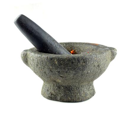 herbolaria: Stone mortero y mano de mortero Foto de archivo
