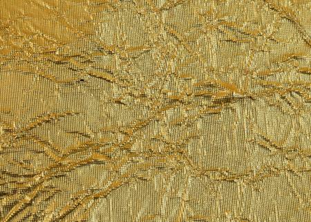 Golden aluminum foil texture background photo