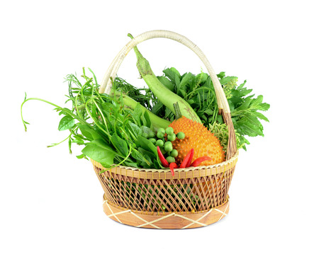 Vegetables in the basket isolated on white background. photo