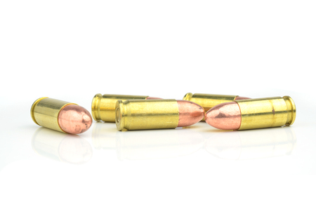 full jacket bullet: 9mm bullet for a gun isolated on white background.