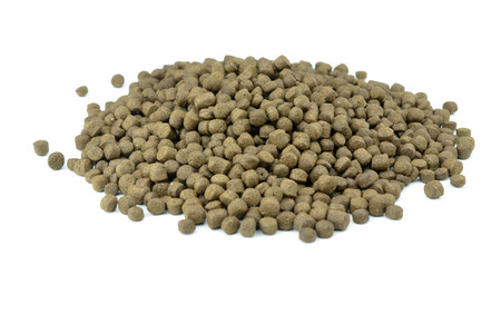 Fish food pellets Stock Photo