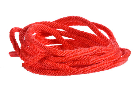 Red rope isolated on white background.