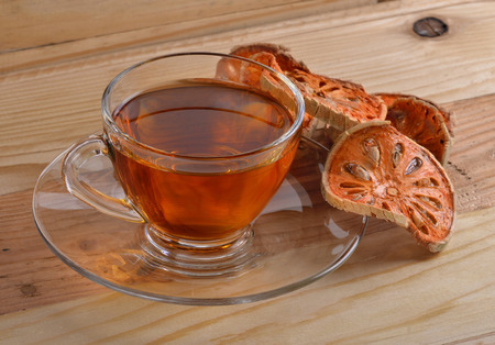 membrillo: Dried quince and Quince water in glass on wooden table,