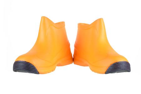 Orange boots isolated on white background.
