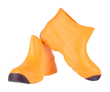 men s boot: Orange boots isolated on white background.