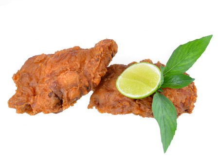 Fried chicken with lemon isolated on white.