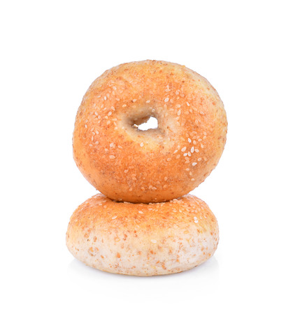 Sesame seeded bagel viewed from above isolated against white Stock Photo