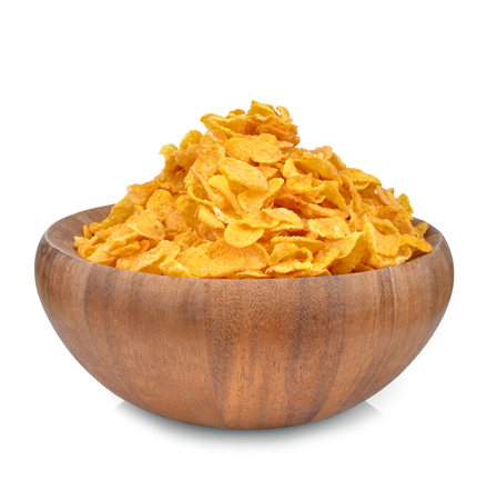 Wooden bowl of cornflakes, isolated on white background Stock Photo