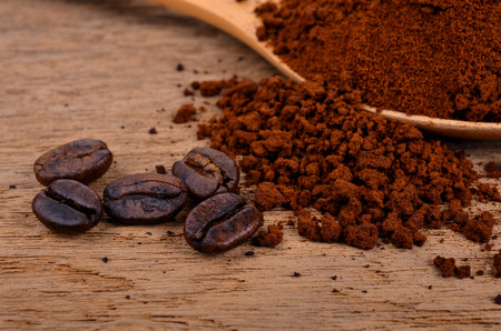 coffee beans and ground coffee on a wooden background Stock Photo