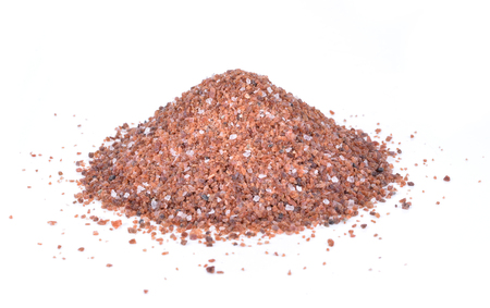 small pile of Himalayan black salt isolated on a white background.