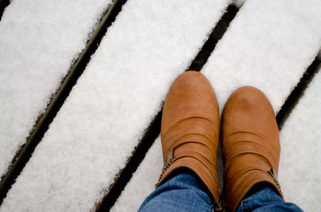 women in boots: women boots in the snow Stock Photo
