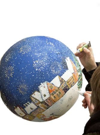 Artists paint a picture on the ball photo
