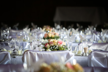 flower arrangement white table: Laid table at a wedding reception