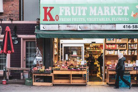 Toronto, ON Canada 12/27/19: Street scene of old style fruit market store on Roncesvalles Avenue.