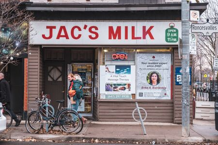 Toronto, ON Canada 12/27/19: Street scene of old style convenience store on Roncesvalles Avenue. Sajtókép