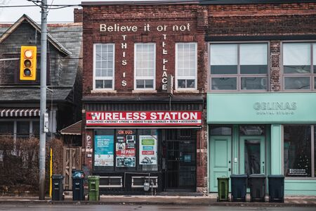 Toronto, ON Canada 12/27/19: Street scene of an old wireless phone store in the Parkdale neighbourhood.
