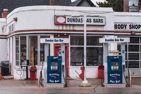 Toronto, ON Canada 12/27/19: Street scene of old school gas station in the Dundas St Little Portugal neighbourhood.