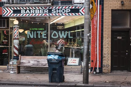 Toronto, ON Canada 12/27/19: Street scene of old school barbershop in the Dundas St Little Portugal neighbourhood.